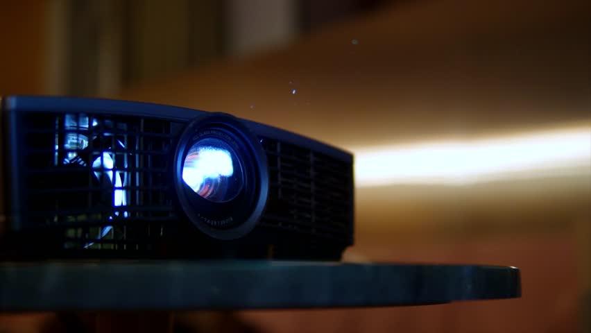 Digital multimedia projector standing on the rack in work.    Shutterstock HD Video #1020517849