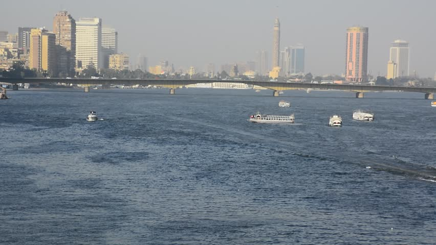 Nile river in Cairo Egypt during the day with boats running and high building surrounding river banks | Shutterstock HD Video #1020533629