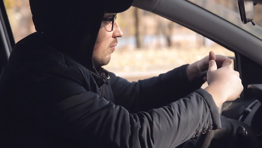 A private detective or a spy conducts surveillance of the object of surveillance. A man secretly taking pictures from the car window | Shutterstock HD Video #1020566689