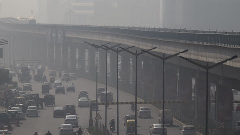 NEW DELHI, INDIA - NOV 24: Metro train and traffic among dangerously high levels of air pollution on November 24, 2018 in New Delhi, India