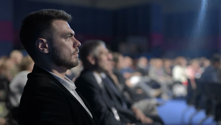 Crowded banking forum working in modern large place. Caucasian attractive listener looking speaker speech on row of seats. Marketing information for success politics development of economy corporation | Shutterstock HD Video #1020788569