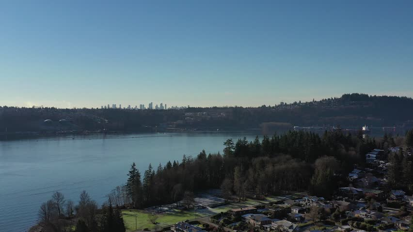 Aerial view over Burrard Inlet, ocean and island with boat and mountains in beautiful British Columbia. Canada. | Shutterstock HD Video #1020790459