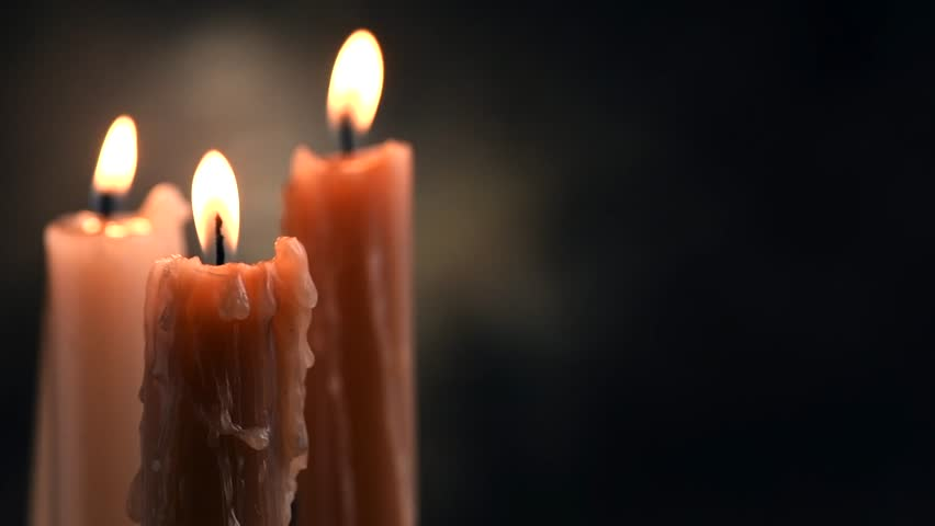 Candles flame close up on a dark background. Candle light border design. Melted Wax Candle Burning at Night. White Candles Burning in the Dark. Candlelight. Slow motion 4K UHD video | Shutterstock HD Video #1020791299