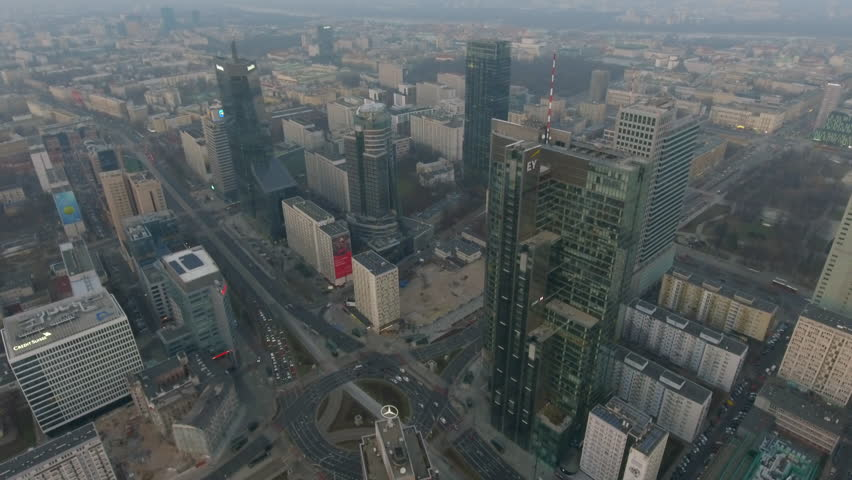 Aerial view of the business center of Warsaw. 29. November. 2018. Modern skyscrapers are illuminated with the sure sun at sunset. #1020807079
