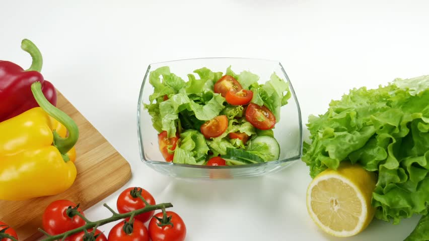Healthy food. Vegetarian food. Young man coocking vegetable salad observing diet and counting calories wellness. Top view | Shutterstock HD Video #1020821749