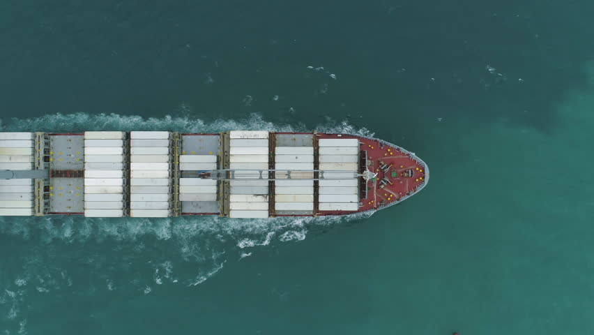 Large Cargo Ship with Containers in the Sea. Aerial Vertical Top-Down View. Drone is Flying Sideways #1020886279