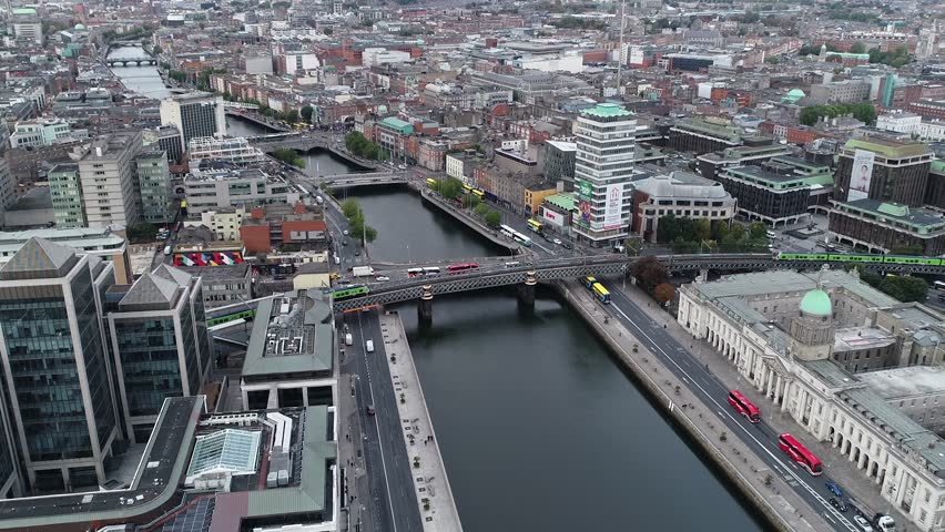The Timelapse includes the Custom House, the new Ulster Bank building and two trains going across its tracks over the River Liffey.   Shutterstock HD Video #1020927259