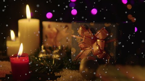 Decoration chirstmas with candle burning, gift and snow footage. Christmas day