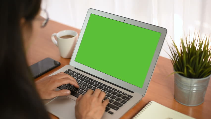 Young business start up, Young Owner Woman Start up for Business Online Working at home, Over the shoulder shot of a woman typing on a computer laptop with a key-green screen in home. | Shutterstock HD Video #1021001269