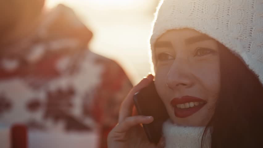 Couple Calling Her friends in Christmas | Shutterstock HD Video #1021018669
