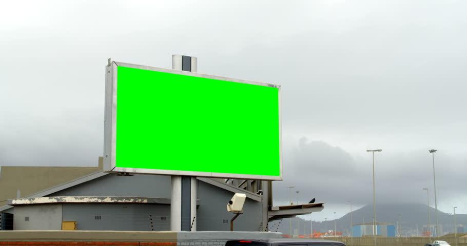 Led hoarding on the city street. Green screen display on the hoarding 4k | Shutterstock HD Video #1021107319