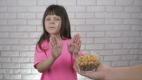 Kid refuses offering of nuts. Child doesn't want nuts. Allergik kid.