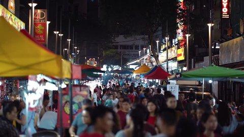 BUKIT BINTANG, KUALA LUMPUR - DEC 2018 : People walking at Jalan Alor Night Market, Bukit Bintang. A famous tourists attraction.