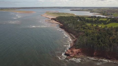 Aerial view of a beautiful rocky shore on the Atlantic Ocean. Taken in Cabot Beach Provincial Park, Prince Edward Island, Canada.