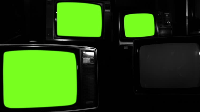 "Old Tvs Turning On Green Screen. Black and White Tone. Ready to Replace Screens with any Footage or Picture you Want. You can do it with ""Keying"" (Chroma Key) effect. 