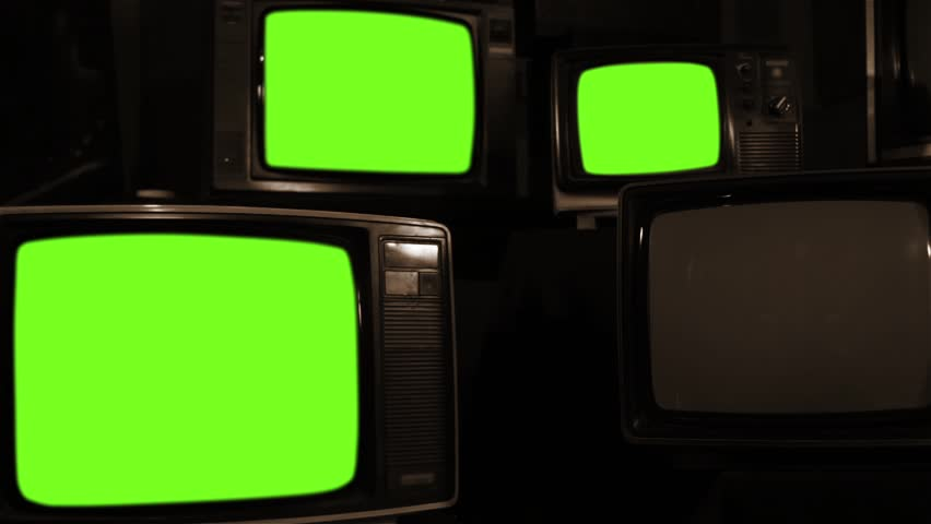 "Old Tvs Turning On Green Screen. Sepia Tone. Ready to Replace Green Screen  with any Footage or Picture you Want. You can do it with ""Keying"" (Chroma Key) effect in Adobe After Effects. 