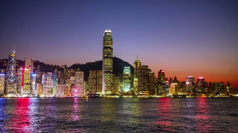 Hong Kong Island Skyline and Victoria Harbor at Night View - time lapse