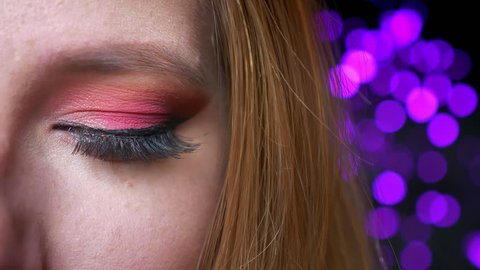 4f1a8011010 Closeup of gorgeous blue eye makeup with pink shades and long eyelashes