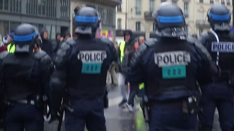 Paris / France/ 16.12/2018 / Gillets Jaune next to Opera metro station in Paris, Police officers stands still with yellow wests manifestants