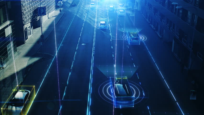 Aerial Drone Shot: Autonomous Self Driving Cars Moving Through City. Concept: Artificial Intelligence Scans Cars and Pedestrians, Following Movement and Showing Data. | Shutterstock HD Video #1021307839