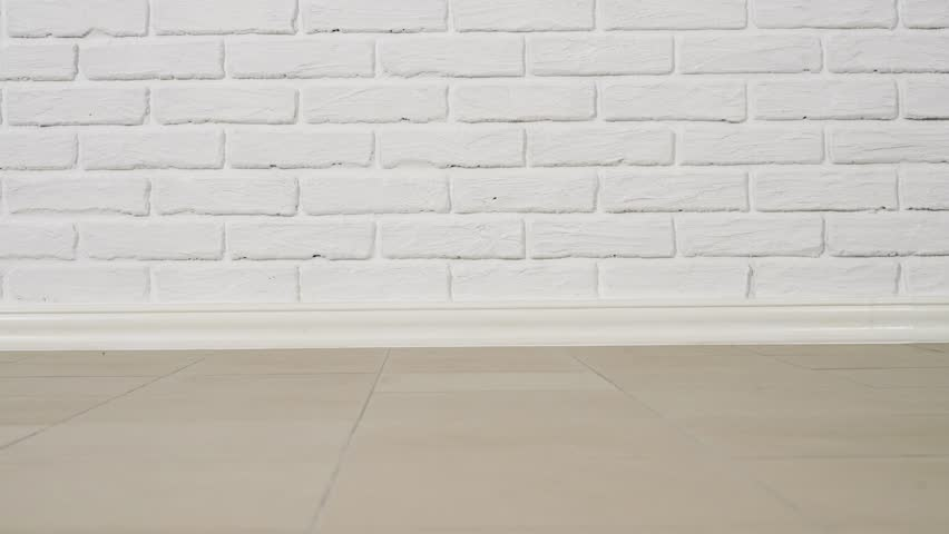 white brick wall and tiled floor as background