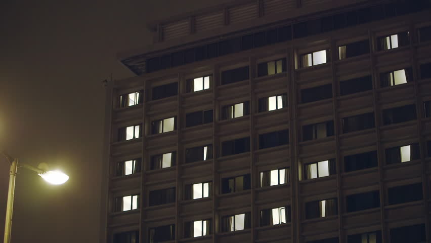 Hospital building exterior, night,room windows.Real time night exterior view of the face of a big city hospital.   Shutterstock HD Video #10214579