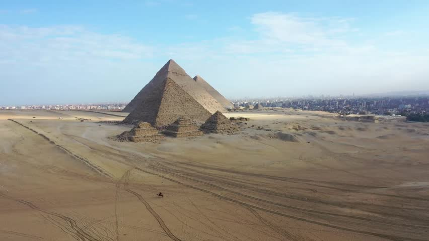 Aerial view of giza pyramids landscape. historical egypt pyramids shot by drone.   Shutterstock HD Video #1021470469
