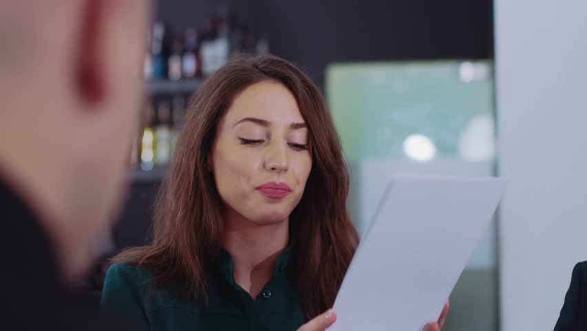 Young attractive woman at business meeting with friends laughing talk sitting in cozy restaurant. slow motion close up | Shutterstock HD Video #1021506169