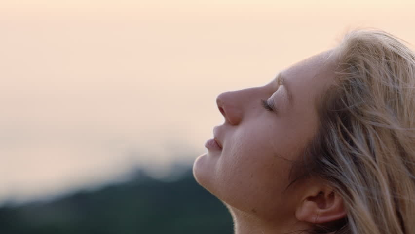 Portrait beautiful woman looking up praying enjoying peaceful sunset exploring spirituality contemplating journey relaxing outdoors | Shutterstock HD Video #1021561279
