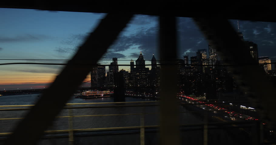 New York City downtown skyline from subway train window