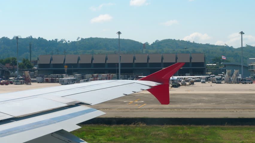 PHUKET, THAILAND - NOVEMBER 22, 2018: View from porthole departing aircraft runway accelerate | Shutterstock HD Video #1021636039
