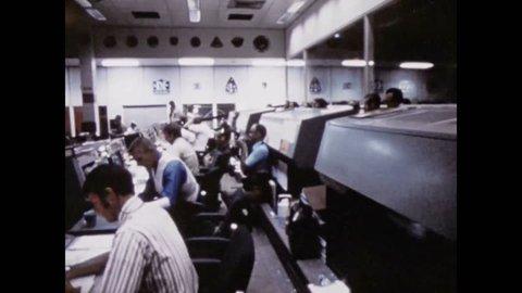 CIRCA 1970s - The Lyndon B. Johnson Space Center is shown as well as Apollo 15 astronauts driving the Lunar Rover.