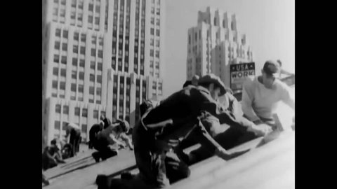 CIRCA 1937 - WPA laborers repair the roof of the New York Public Library. Land and seaplanes are seen at Brooklyn's Floyd Bennett Airport.