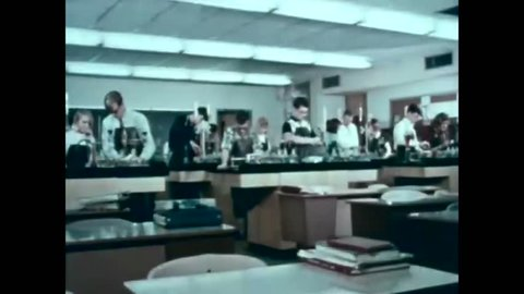 CIRCA 1965 - High school students are seen in science class.