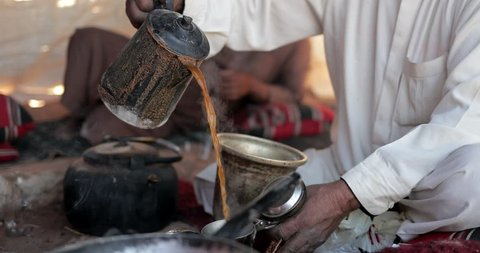 A Bedouin Man Cooks Coffee and Tea In A Traditional Way In The Wadi Rum, Jordan