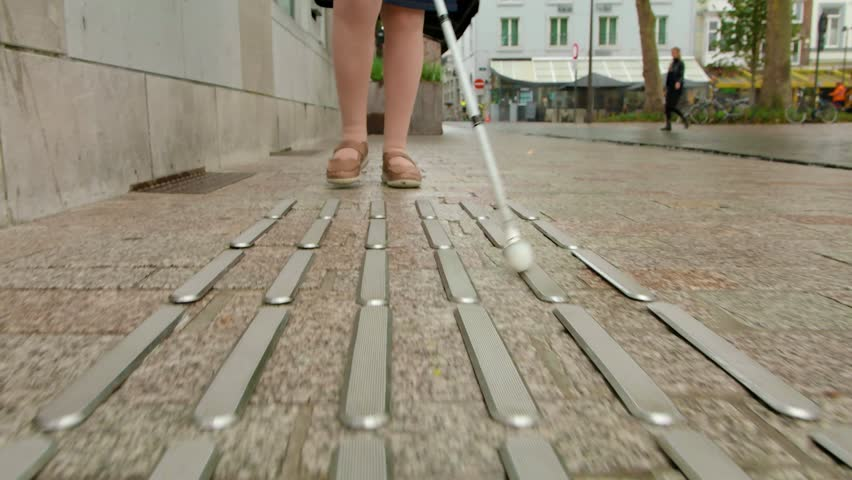 tactile paving walking woman with blind cane #1021727899