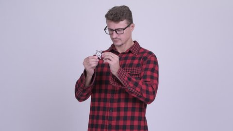 Happy bearded hipster man playing with fidget spinner