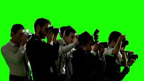 Group of paparazzi or journalists. Photo shoot on green screen. Slow motion. Shot on RED EPIC Cinema Camera.