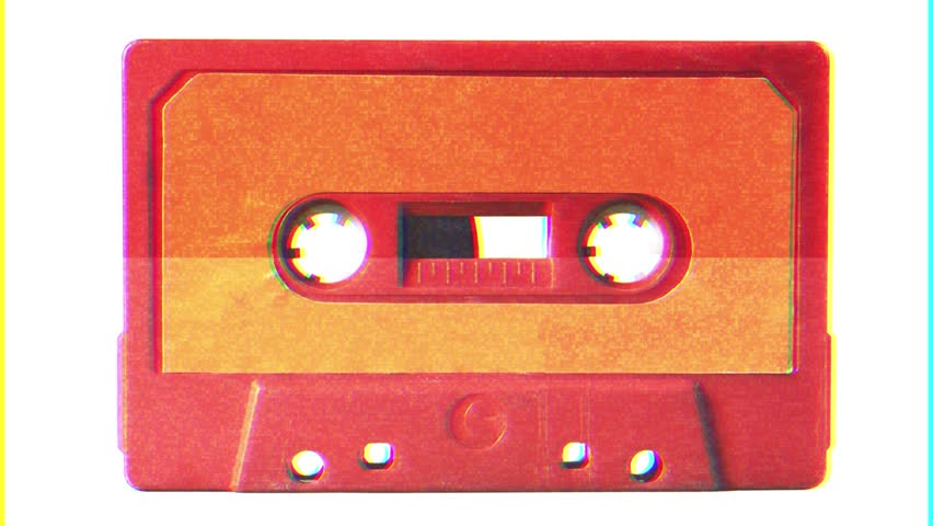 Noise distortion fx tv transmission: an old vintage cassette tape from the 1980s (obsolete music technology). Vivid colors: coral red plastic body, orange paper label, isolated on white.  | Shutterstock HD Video #1021963819