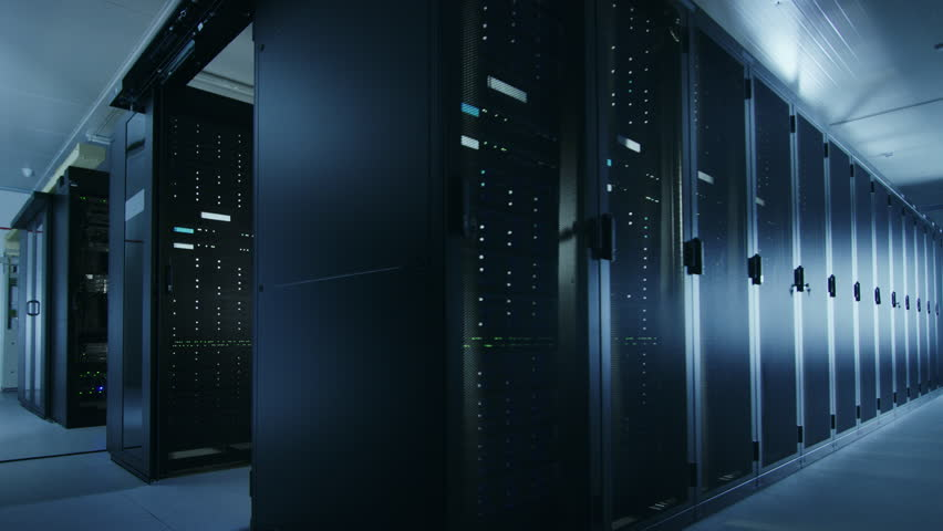 Camera Walkthrough Shot of a Working Data Center With Rows of Rack Servers. Led Lights Blinking and Computers are Working. Room is Dark. | Shutterstock HD Video #1021974739