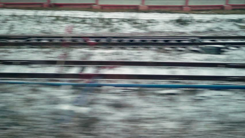 Rails at railroad at winter day.   Shutterstock HD Video #1022001619