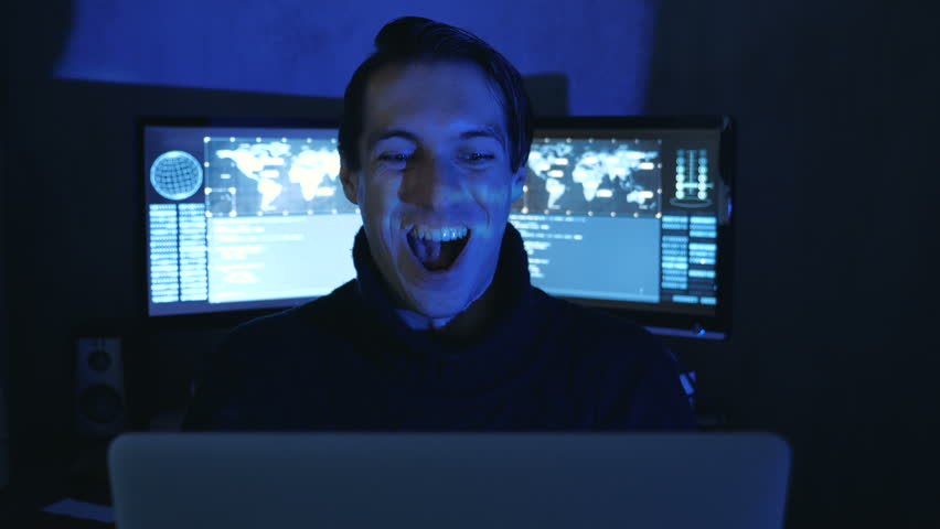 Portrait of Happy Surprised Geek Programmer in a data center filled with monitor screens. Sudden Victory or Success | Shutterstock HD Video #1022084959
