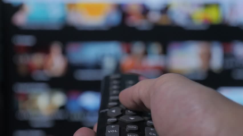 Smart tv. online video streaming service. with apps and hand. Male lifestyle hand holding remote the control turn off smart tv. man hand controls holding remote. concept internet online cinema | Shutterstock HD Video #1022107279