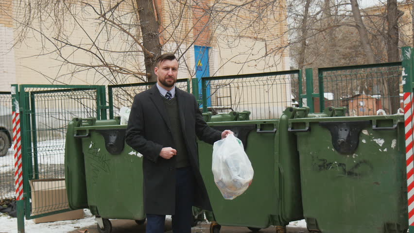 Business man in suit is throwing out the trash in the trash can | Shutterstock HD Video #1022132059