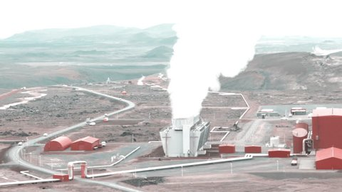 Geothermal power station in Iceland. Generation of ecologically clean renewable energy. Landscape of geothermal sources and geothermal energy plant. Foggy day, selective focus.