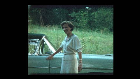 Proud Woman shows off new car 1953