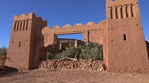 Towers of Kasbah Ait Ben Haddou in the Atlas Mountains at sunset, Morocco, zoom in 4k