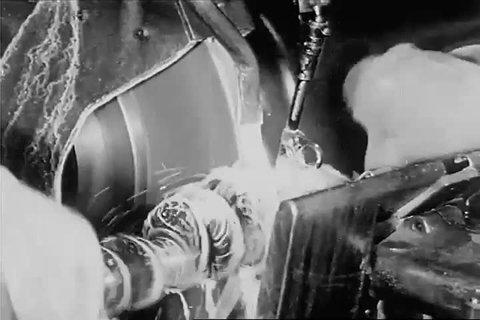 Circa 1920 - a carborundum wheel is used to cut through brass