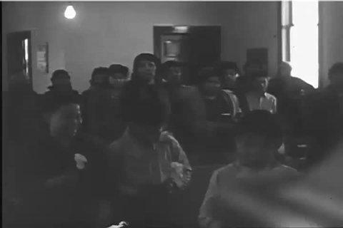 CIRCA 1943 - A Methodist minister begins his sermon to a Paiute congregation.