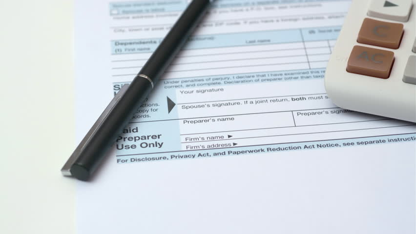 Filling Out Us Income Tax Stock Footage Video (100% Royalty-free)  1022237059 | Shutterstock